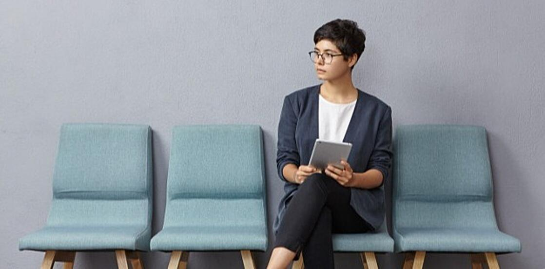 cute-businesswoman-looks-pensively-aside-waits-meeting-with-partners_273609-8264-2